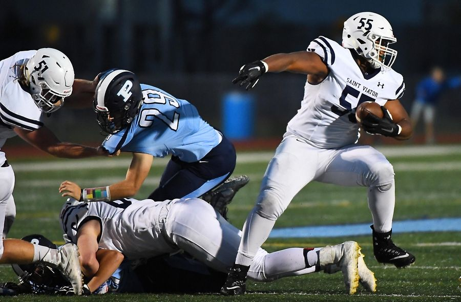St. Viator's Jeremiah Pittman (55) is just one of the many Illinois high school football players coping with the IHSA's suspension of summer contact days.