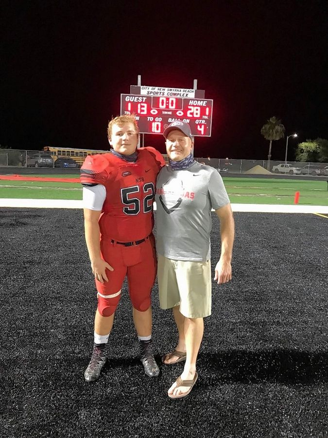 Brett Kuczynski, left, and his dad Mike. Brett, a former Montini football player, now plays for New Smyrna Beach High School in Florida. He made the decision to leave Montini when the IHSA football season was moved to spring.