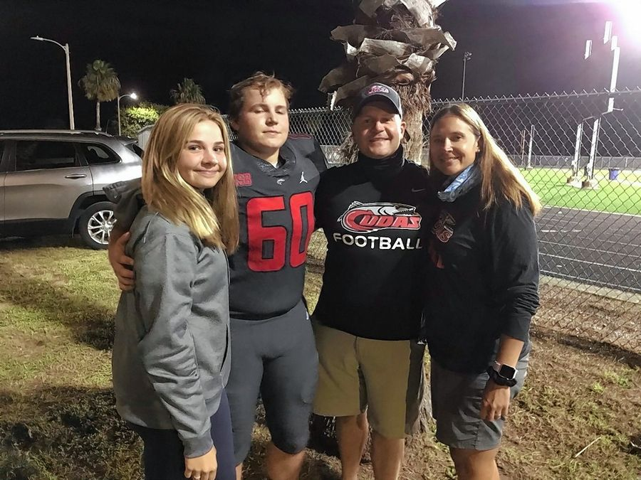 The Kuczynski family. Brooke, a freshman, dad Brett, dad Mike and mom Denise. Brett, a former Montini football player, now plays for New Smyrna Beach High School in Florida. He made the decision to leave Montini when the IHSA football season was moved to spring.